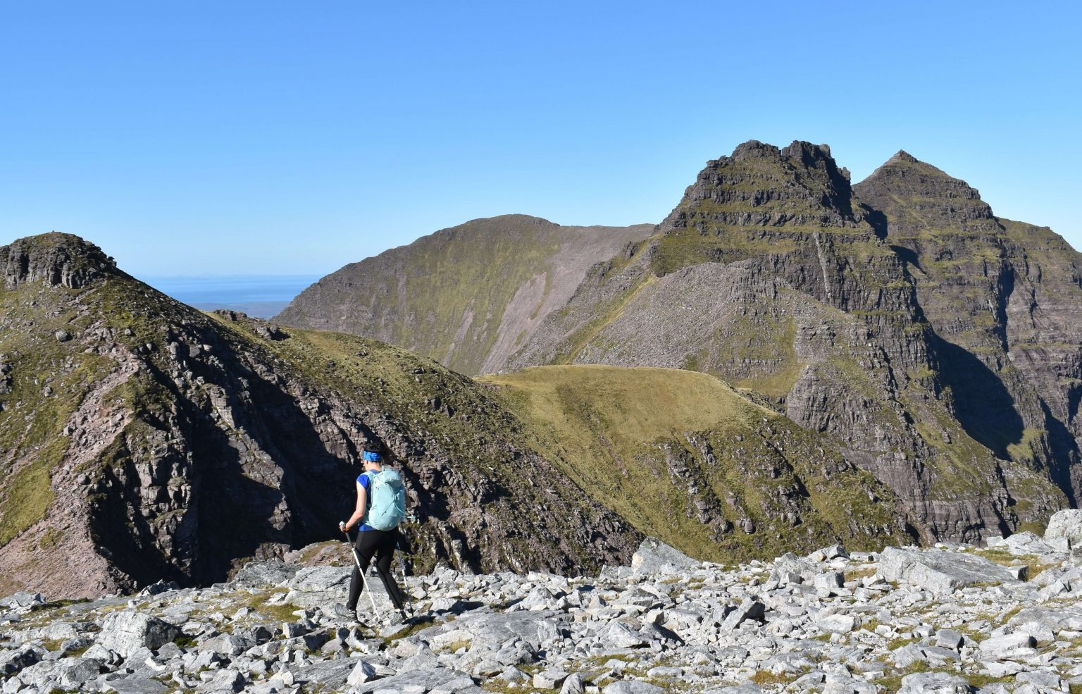 Adventurer Nic walking towards the pinnacles of An Teallach in North West Scotland