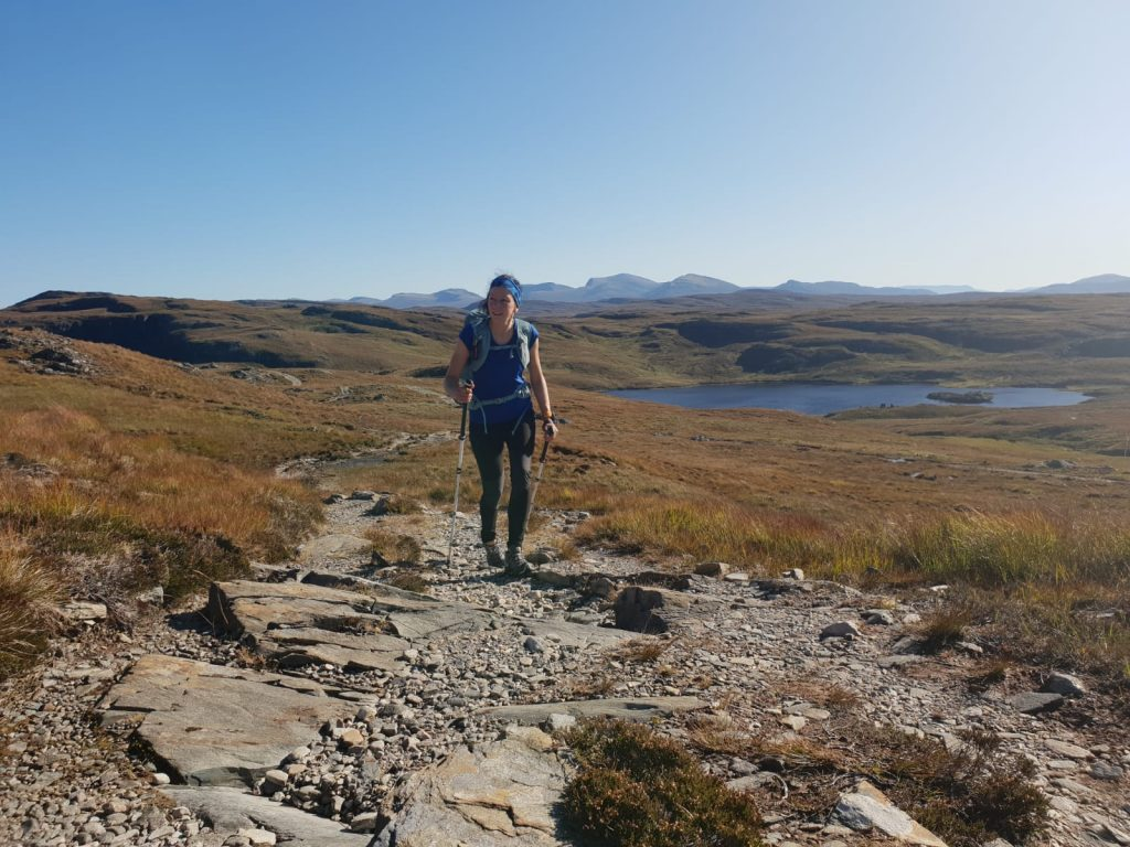 Adventurer Nic on the early part of the walk with Beinn Dearg (Ullapool) and surrounding Munros in the background