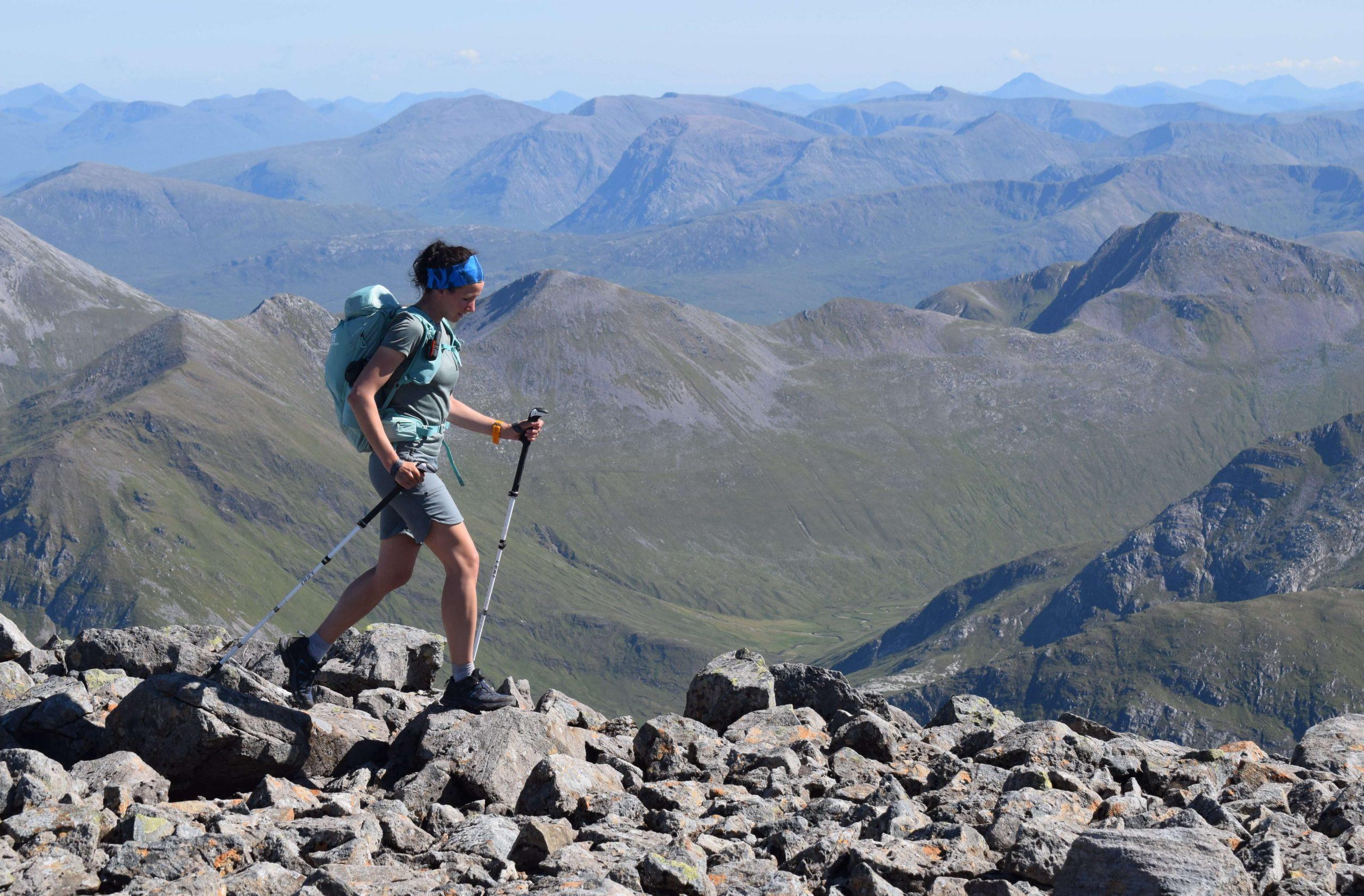 Adventurer Nic walking on Ben Nevis in the Scottish Highlands