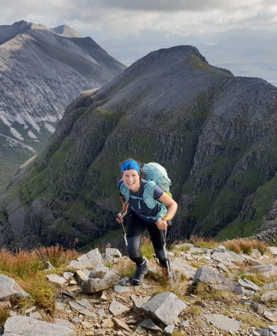 Smiling Adventurer Nic climbing Liathach mountain in the Scottish Highlands