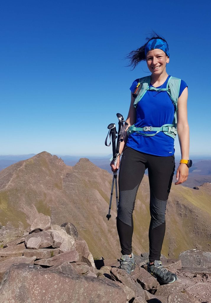 Adventurer Nic on the summit of Sgurr Fiona. A Munro summit on An Teallach in the North West Scottish Highlands