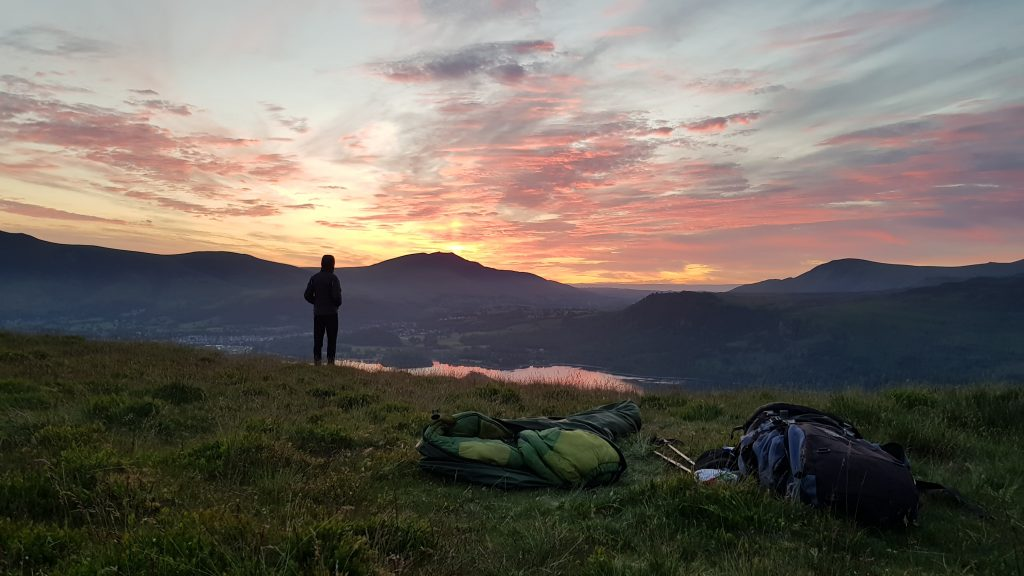 Bivvy bag camp overlooking Derwent Water from Cat Bells at Sunrise