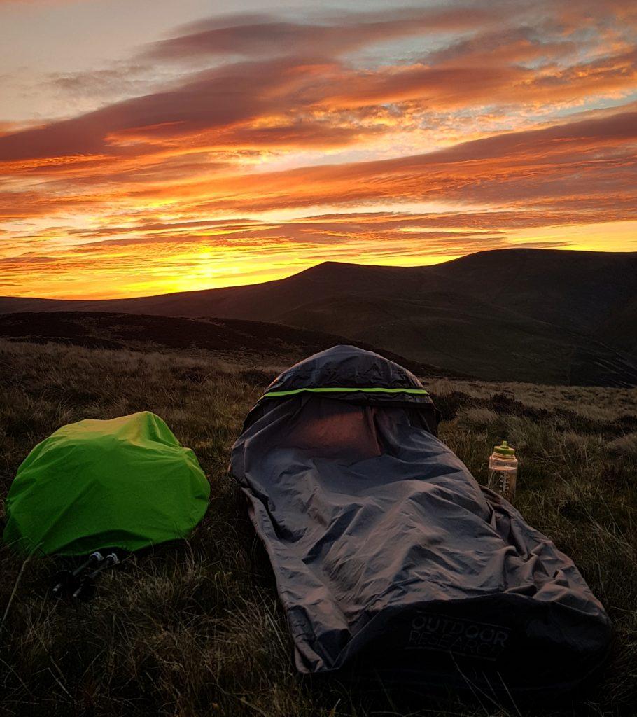 Adventurer Nic's bivvy bag at sunrise on Great Cockup
