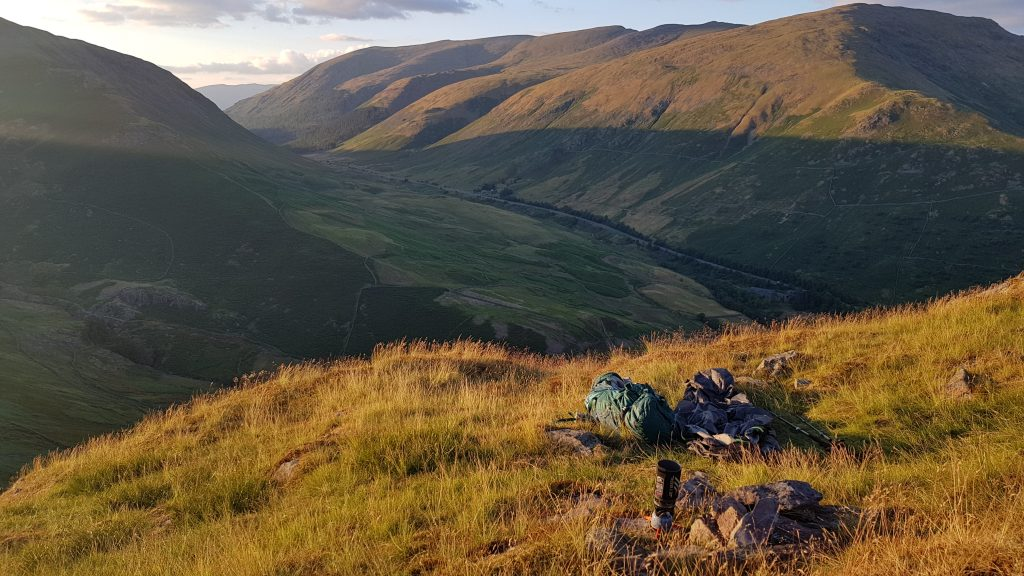 Adventurer Nic's bivvy bag camp on Helm Crag as the sun is going down