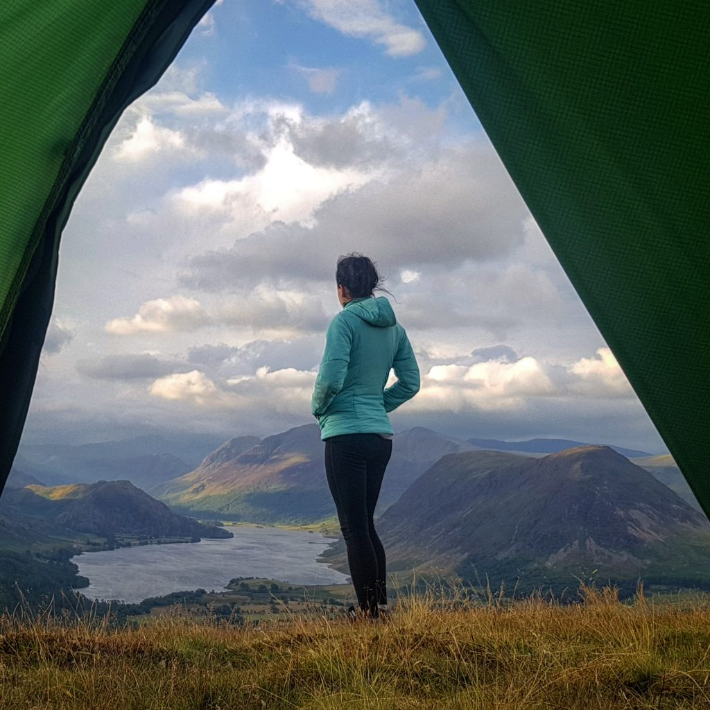 View of Adventurer Nic from her tent at Low Fell, overlooking Crummock Water