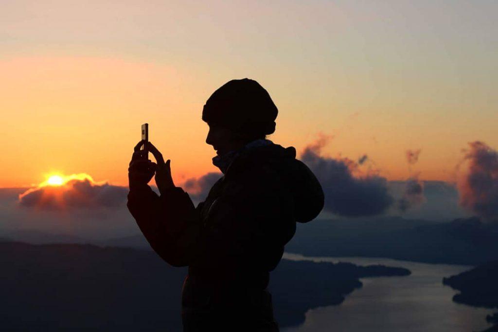 Adventurer Nic capturing the sunrise on Sheffield Pike