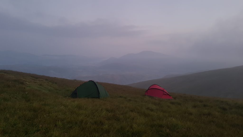 Adventurer Nic and her friends in two tents on Watson's Dodd on a misty morning