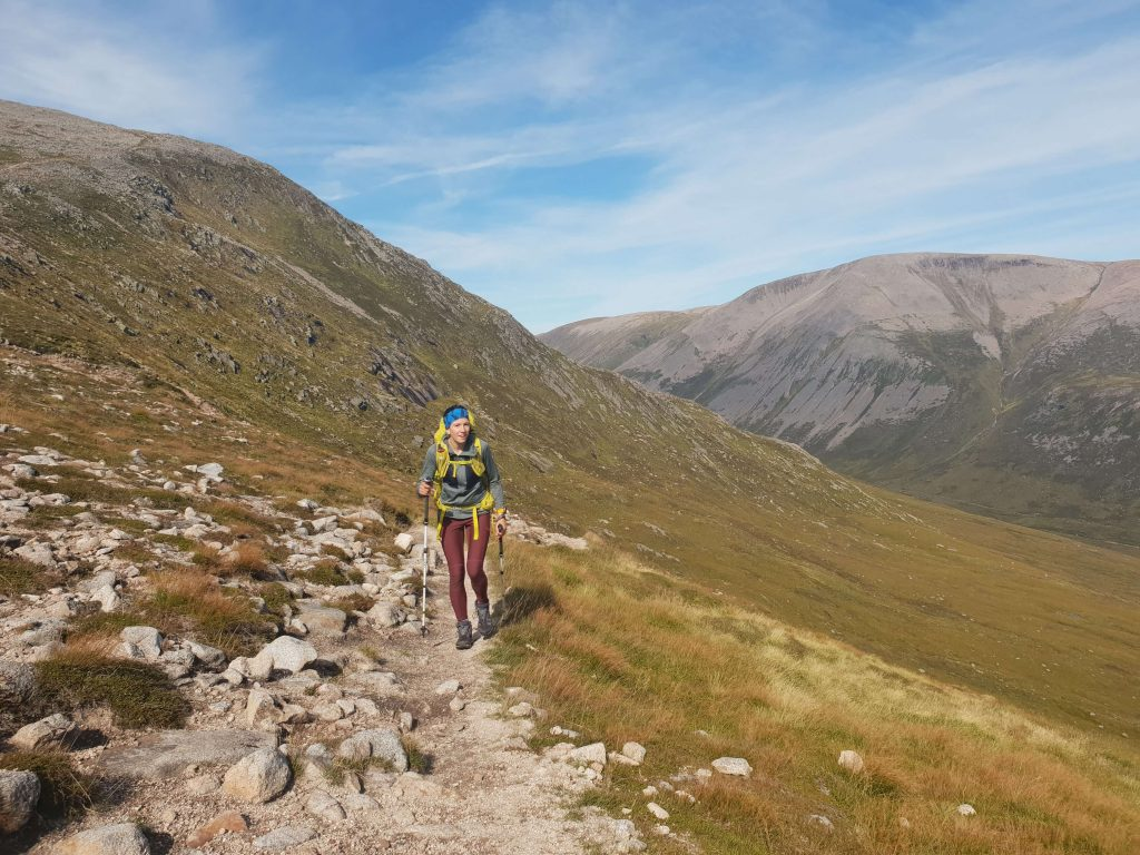 Adventurer Nic ascending The Devil's Point from Corrour Bothy in the Cairngorms