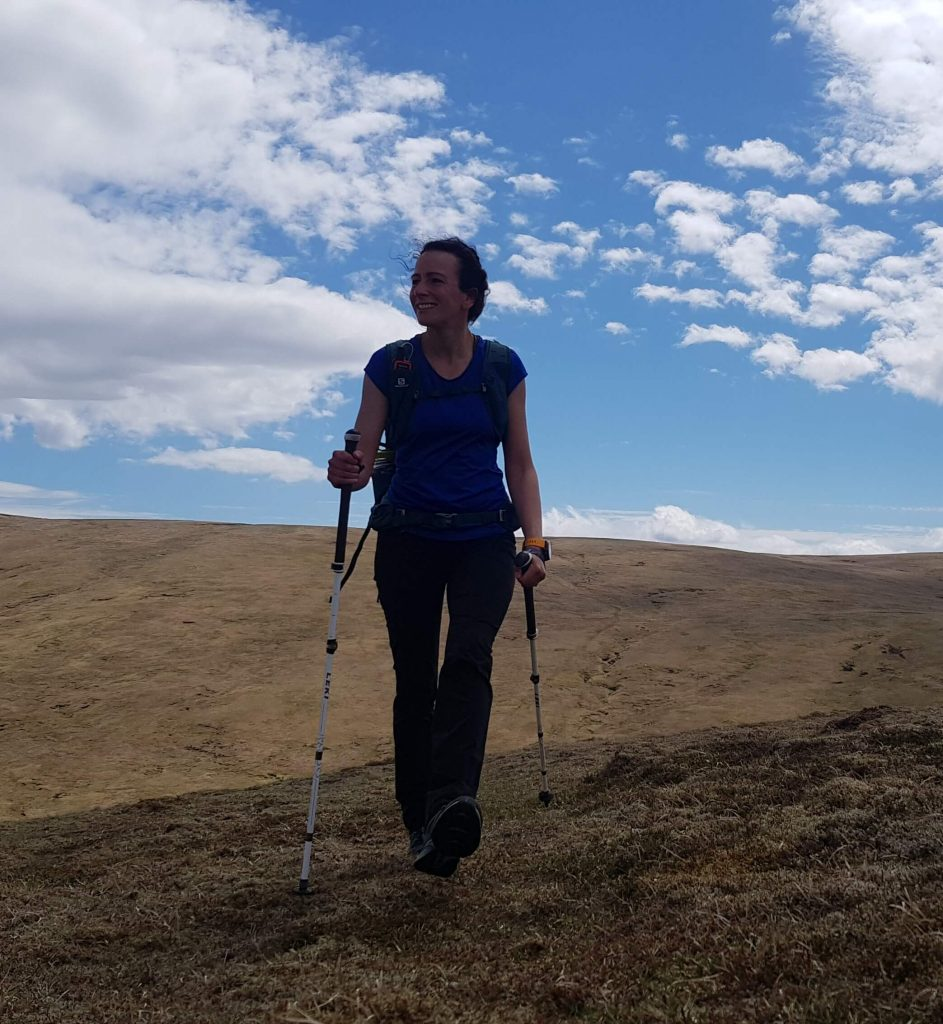 Adventurer Nic hiking towards Carn na Caim - Munro mountain in the Scottish Highlands East of the Drumochter Pass