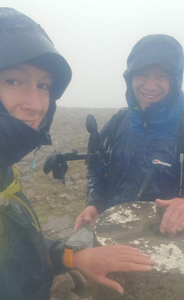 Adventurer Nic and James Forrest pose for a wet selfie on Beinn Bhrotain