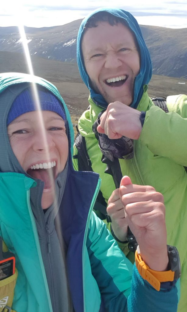 Adventurer Nic and James Forrest celebrate reaching their 14th summit of their Cairngorms Munros expedition