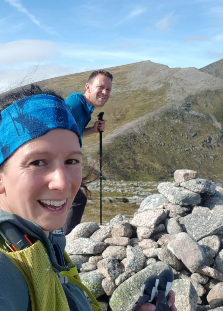 Adventurer Nic and James Forrest on the summit of The Devil's Point in the Cairngorms
