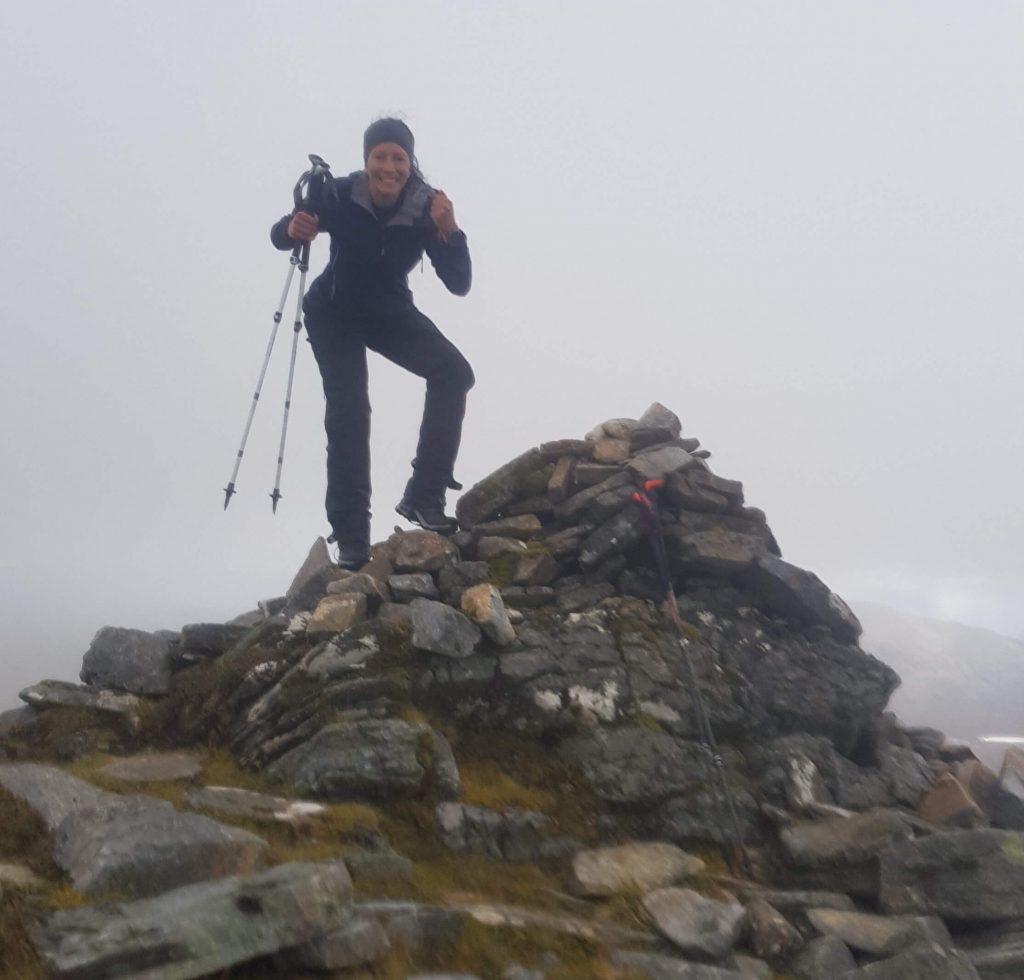 Adventurer Nic on the summit of Lurg Mhor Munro mountain