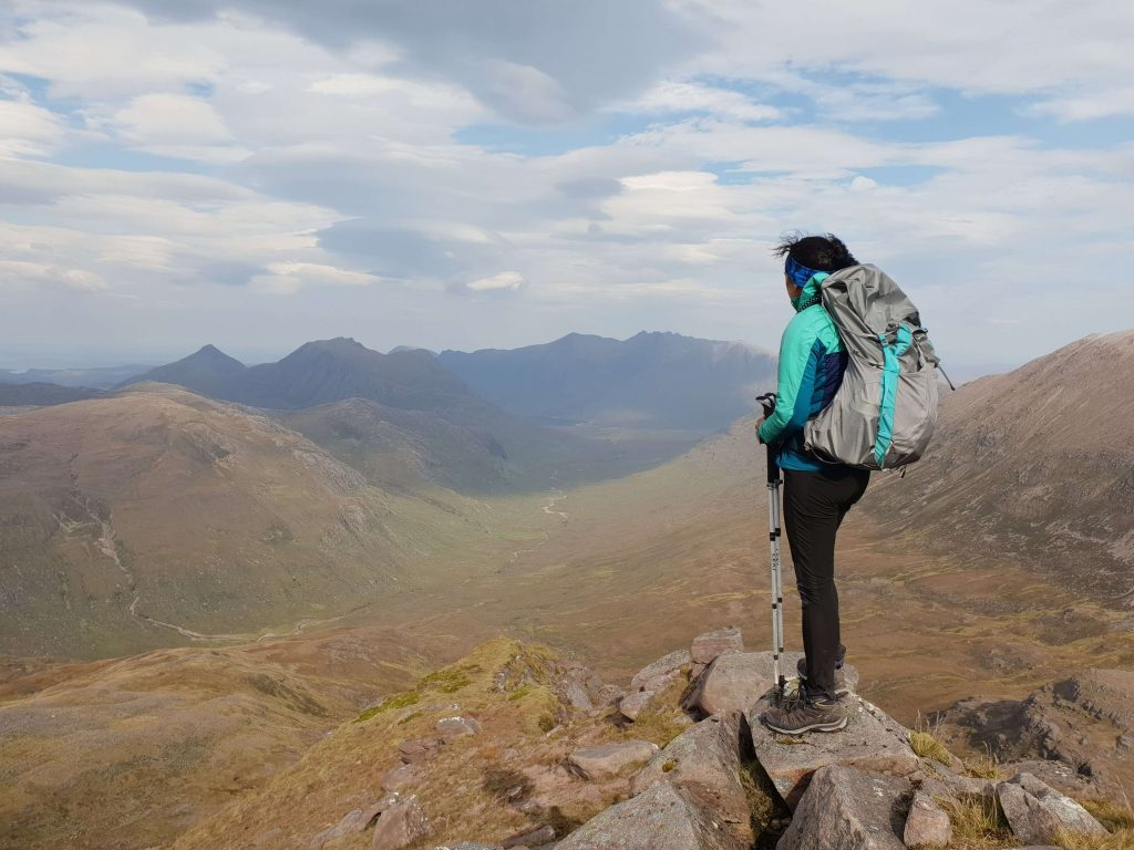 Adventurer Nic looking across to An Teallach from Beinn Tarsuinn - one of the Fisherfield Munros