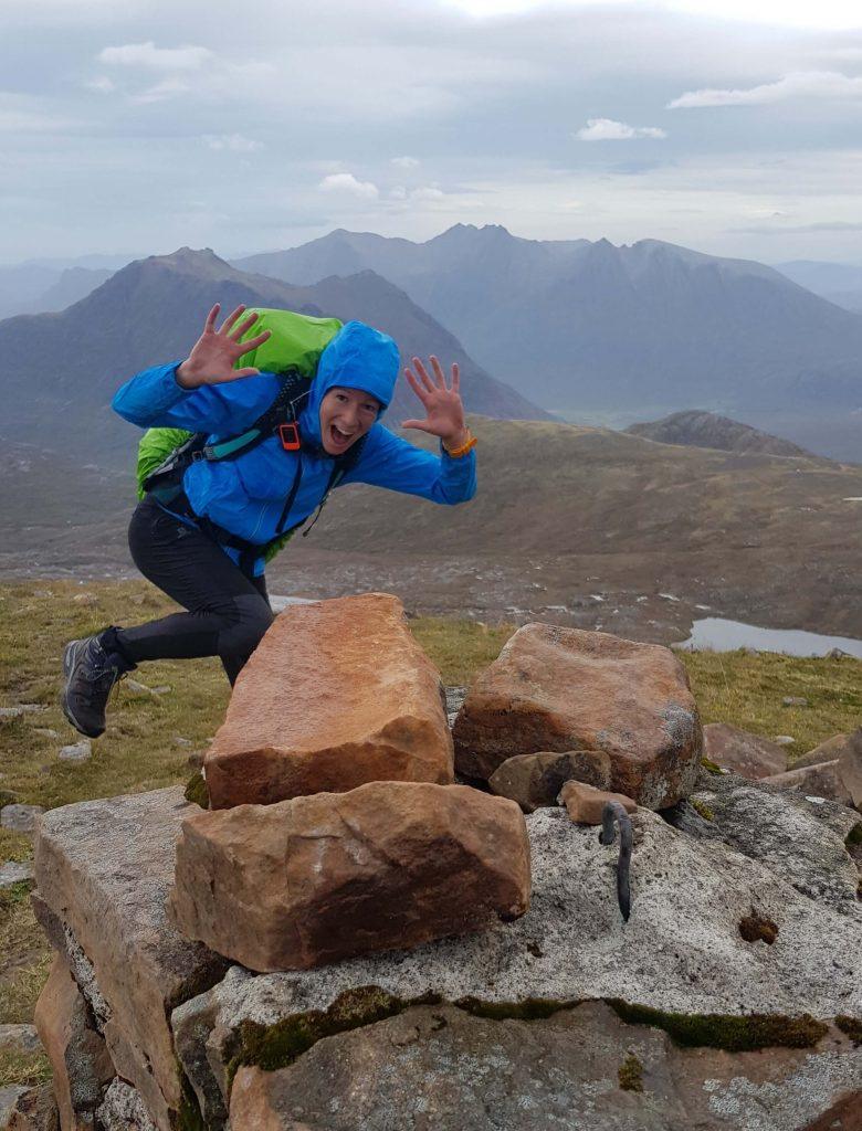 Adventurer Nic, celebrating on the summit of Ruadh Stac Mor - 5 Munros in the bag