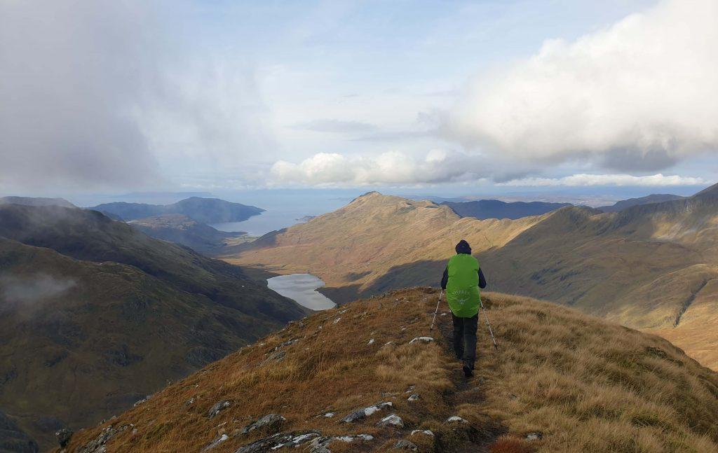 Adventurer Nic descending Luinne Bheinn, looking down over Lochan an Dubh - Lochain, with Inverie just in view
