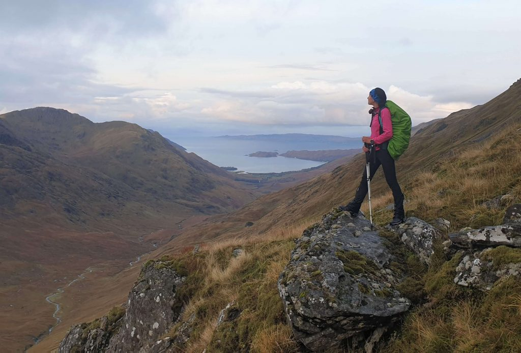 Adventurer Nic pauses on the ascent of Meall Buidhe to admire the view out to the Sound of Sleat