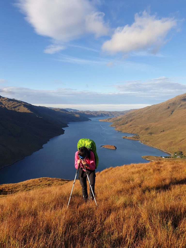 Adventurer Nic resting on her walking poles during the ascent of Sgurr na Ciche - the 4th of the Knoydart Munros