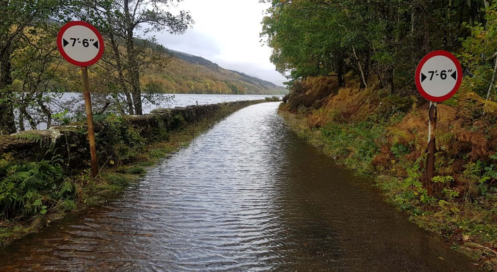 A flooded road at the eastern end of Loch Arkaig temporarily stops Adventurer Nic and James Forrest from hiking the Knoydart Munros