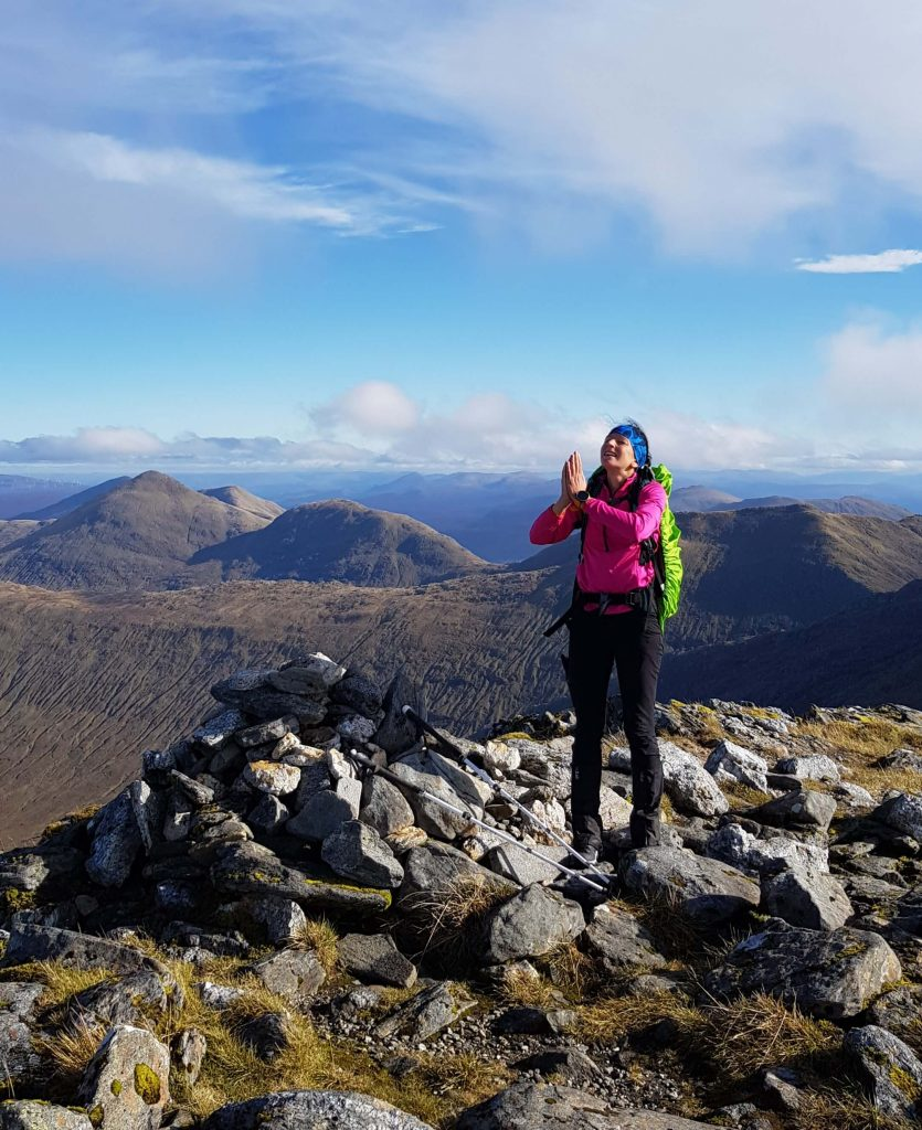 Adventurer Nic on the summit of Sgurr na Ciche, thanking the weather gods for the blessing of seeing Knoydart in all it's glory