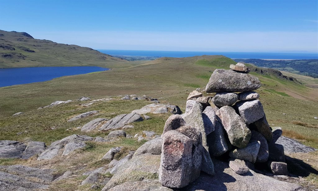 Rough Crags's summit cairn, with views down to Devoke Water
