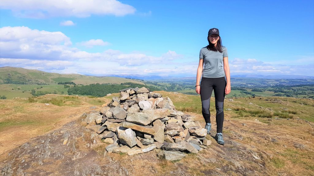 Adventurer Nic on the summit of Reston Scar, the first of two Wainwright Outlying Fells of Lakeland on this hike