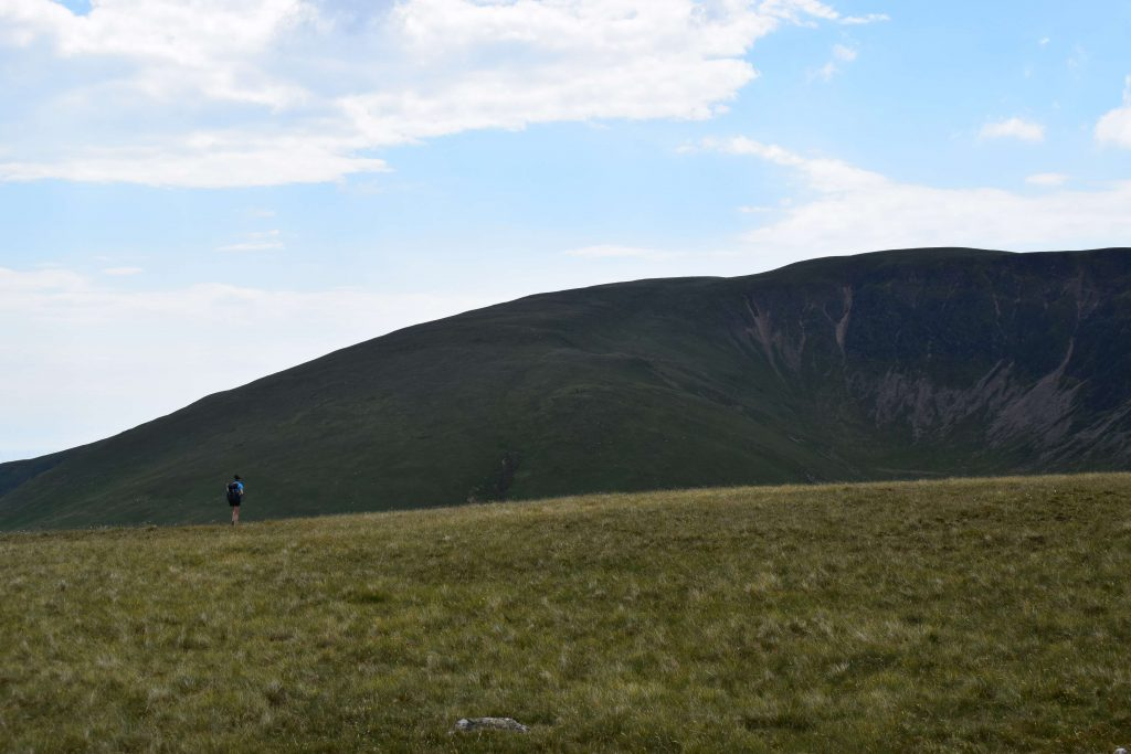 Adventurer Nic taking a closer look at Black Combe from the summit plateau of White Combe