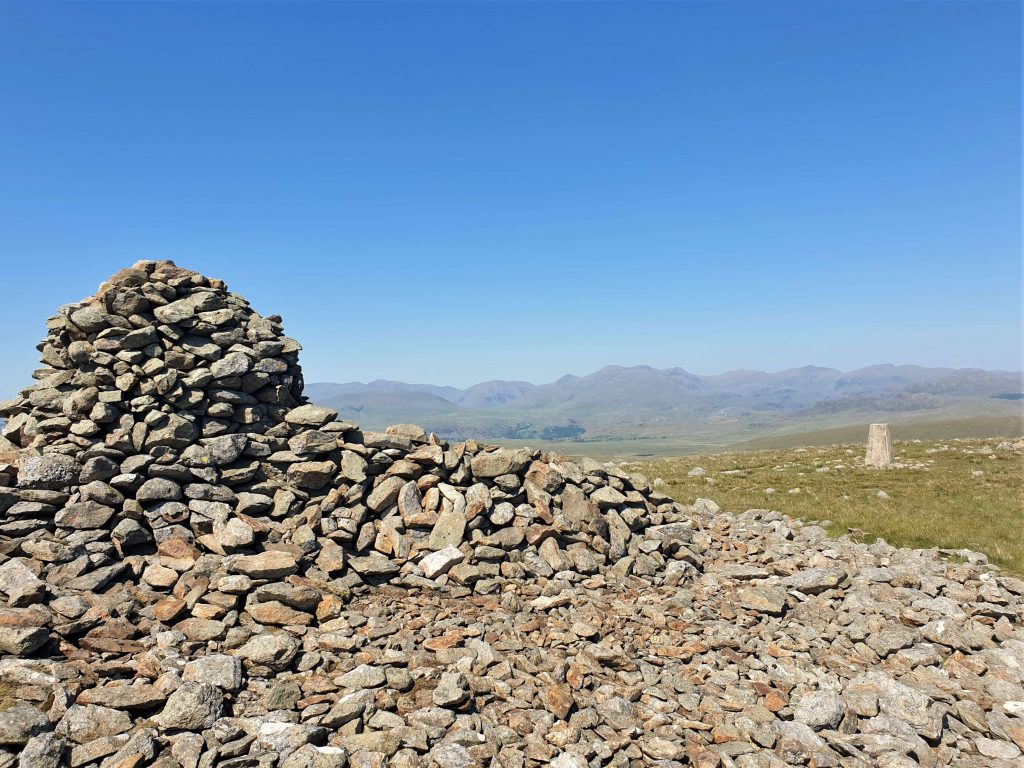 View from Whifell's large summit cairn towards the trig pillar
