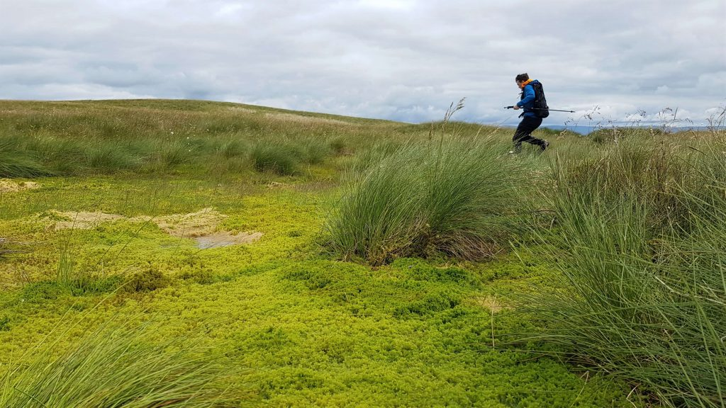 James Forrest jumping over boggy ground, which is common on the Shap Fells