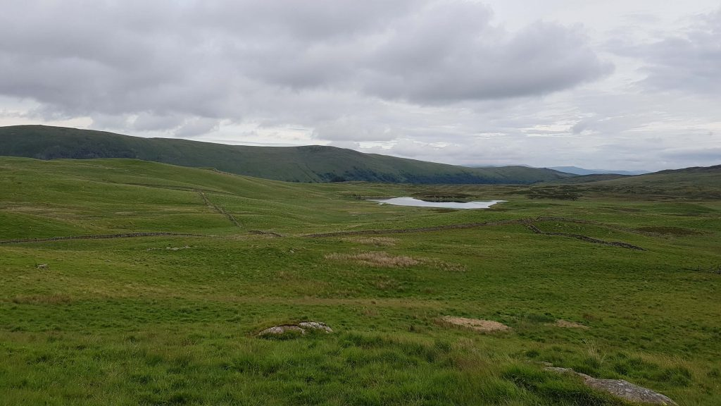 View back to Skeggles Water with the Bannisdale Horseshoe visible in the distance