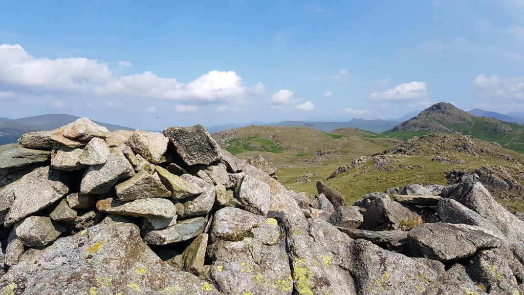 The summit cairn of Great Stickle and Stickle Pike in the background