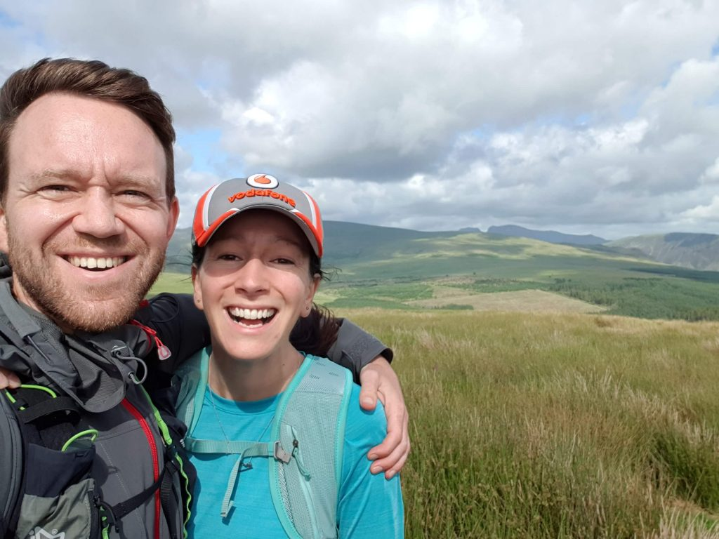 James Forrest and Adventurer Nic smiling on the summit of Ponsonby Fell - the highlight of the day