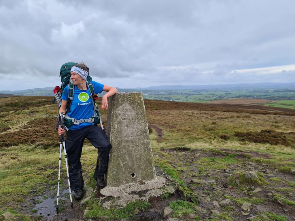 Adventurer Nic on the summit of Pinhaw Beacon on Walk Home 2020