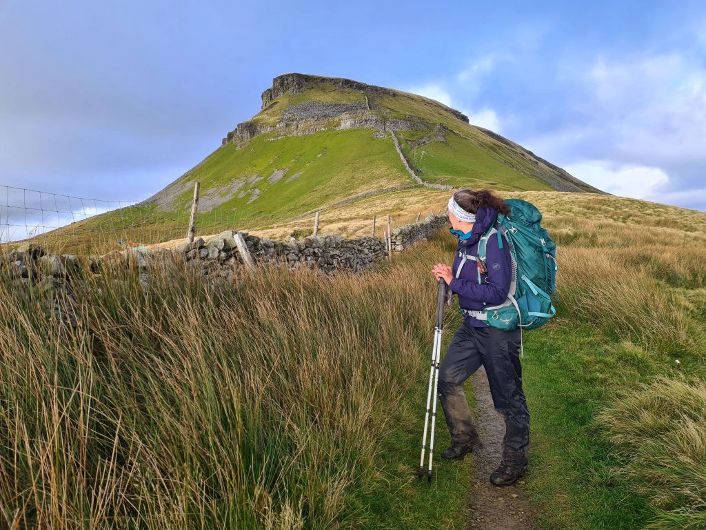 Adventurer Nic approaching Pen-y-ghent in the Yorkshire Dales National Park