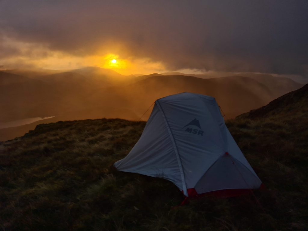 Adventurer Nic's tent pitched for a wild camp in the Lake District National Park on the Walk Home 2020 route