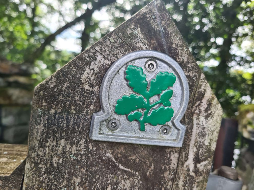 The National Trust emblem on a gate post