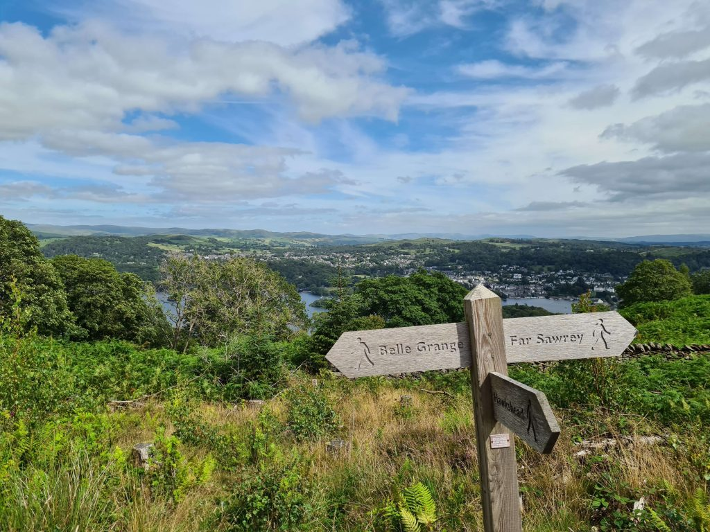 Signpost to Far Sawrey across with a Windermere backdrop