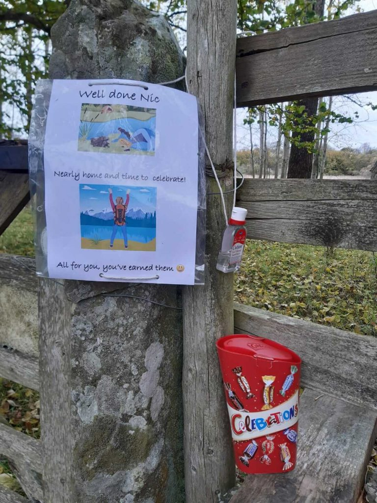 Celebrations chocolates left for Adventurer Nic on a stile near Lorton in Cumbria on the last day of #WalkHome2020