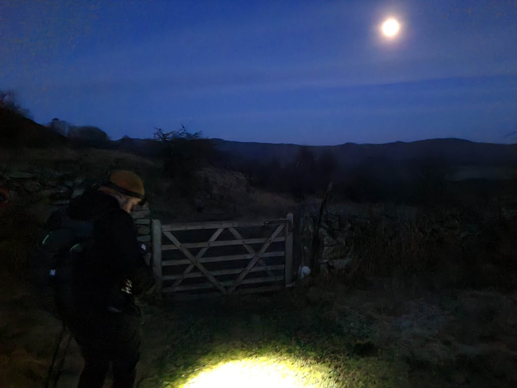 Descending Bigland Barrow by torchlight