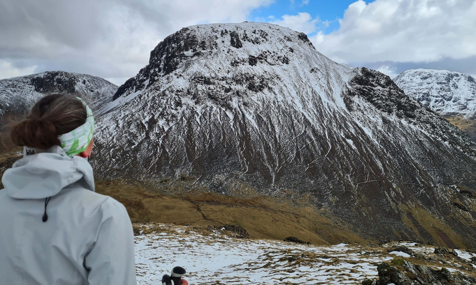 Adventurer Nic looking over at Great Gable from Kirk Fell in the snow during her Walking The Wainwrights Challenge