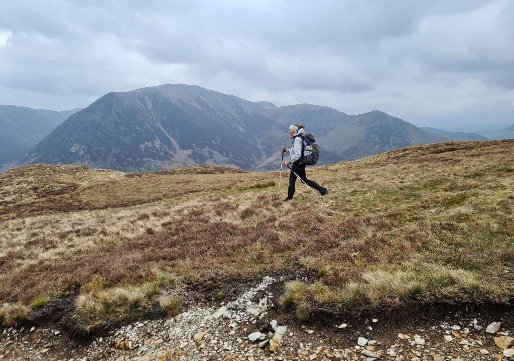 Adventurer Nic walks along Mellbreak in the Western fells on the Walking the Wainwrights adventure